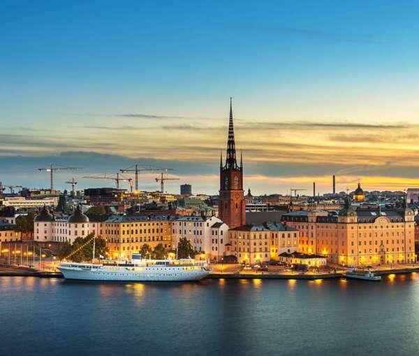 sunset-over-riddarholmen-chruch-in-old-town-stockholm-city--sweden-855564060-5ad546a404d1cf0037fbf9b3